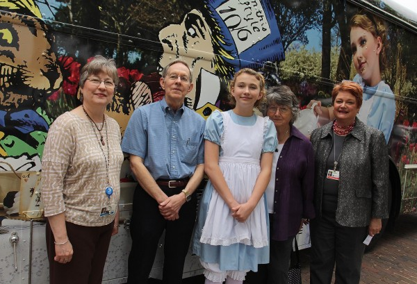 "Friends board members pose with the new bookmobile, ""Alice,"" that was made possible, in part, by Friends funding."