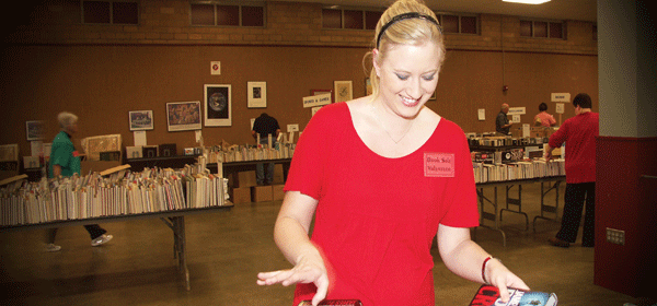 Volunteer helping out at book sale