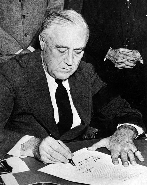 611px-Franklin_Roosevelt_signing_declaration_of_war_against_Japan