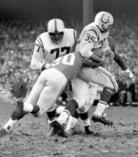 Alan Ameche rumbles for yardage in the 1958 NFL Championship Game