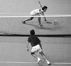 "Billie Jean King and Bobby Riggs on the court during ""The Battle of the Sexes""."