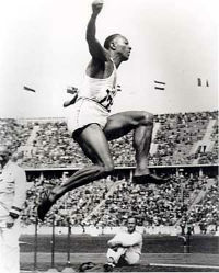 Jesse Owens competing in the long jump at the 1936 Olympic Games.