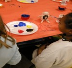 Painting clay story tellers.