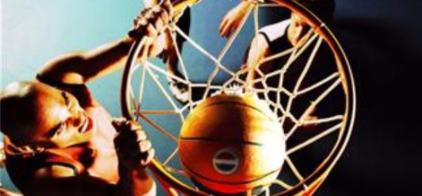 Basketball Player Shooting the Ball in the Basket --- Image by © Royalty-Free/Corbis