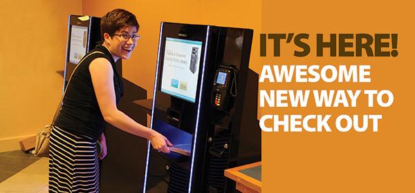 Emma uses the checkout kiosks