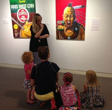 "Curator Heather Kearns helps a group of kids ""get art""."