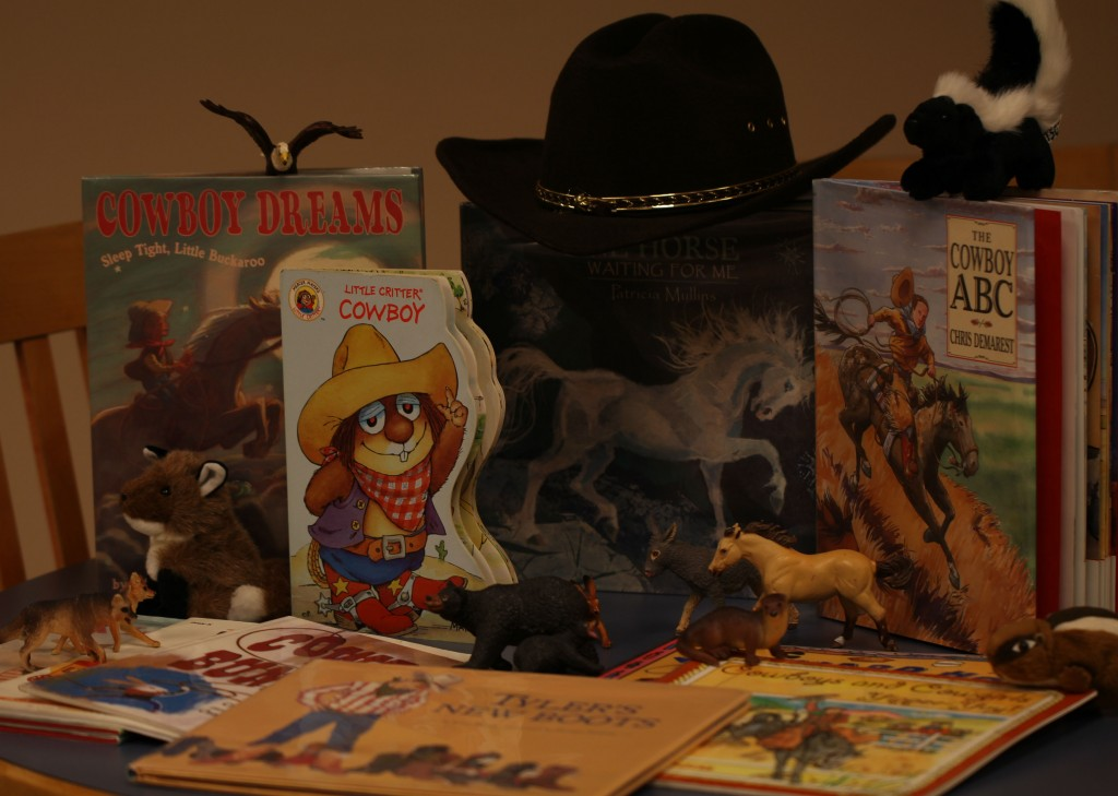 books, puppets, and vinyl animals