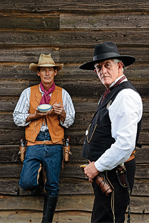 two cowboys old & young