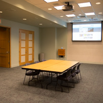 event space meeting room, table, chairs and powerpoint projector