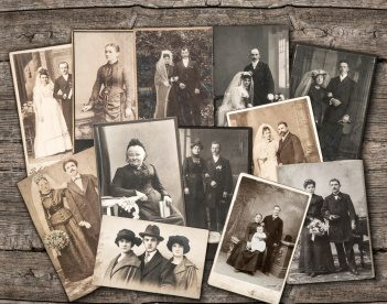 vintage family photos on wooden background