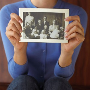 Woman holding old photograph
