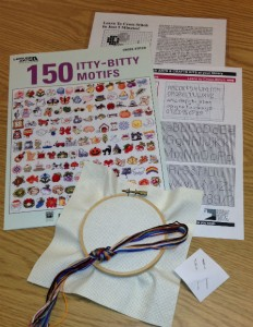 Cross Stitch kit contains instructions, cross stitch designs, embroidery hoop, embroidery floss, and needles.