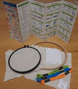 Embroidery Kit contains a stitch guide, embroidery hoops, needles, fabric, and embroidery floss.