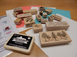 Rubber Stamp kit includes instructions, rubber stamps, stamp pad, and card stock paper.