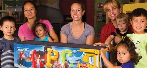 children and parents see a preview of learn and play bus
