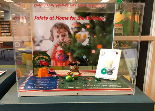 Safely at home for the holidays display highlights beautiful and shiny holiday hazards.