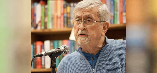 Roy Beckemeyer reads into a mic