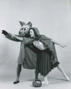 woman in red cape and man in wolf costume