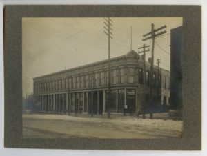 sepia image, newspaper, old building, Topeka