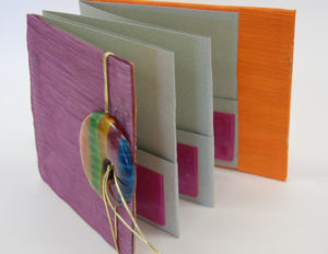 Accordion book with pockets
