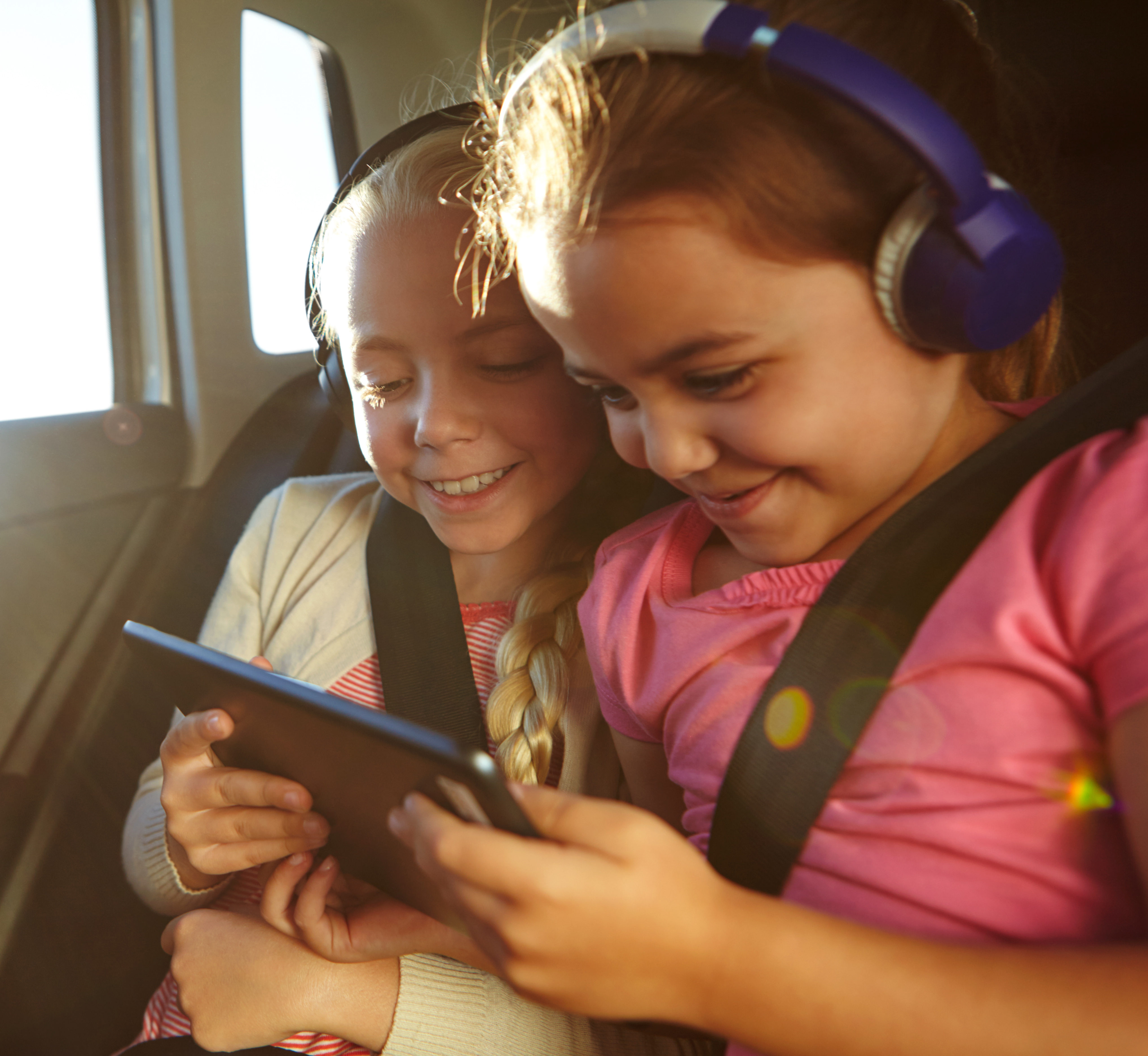 girls wearing headphones with a electronic tablet