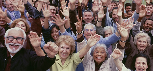 arge group of multi-ethnic people cheering with arms raised