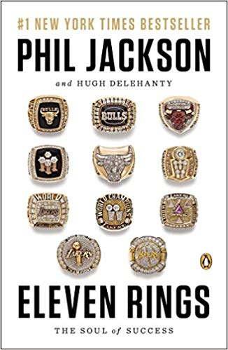 Cover of book Eleven Rings with images of the championship rings Phil Jackson won