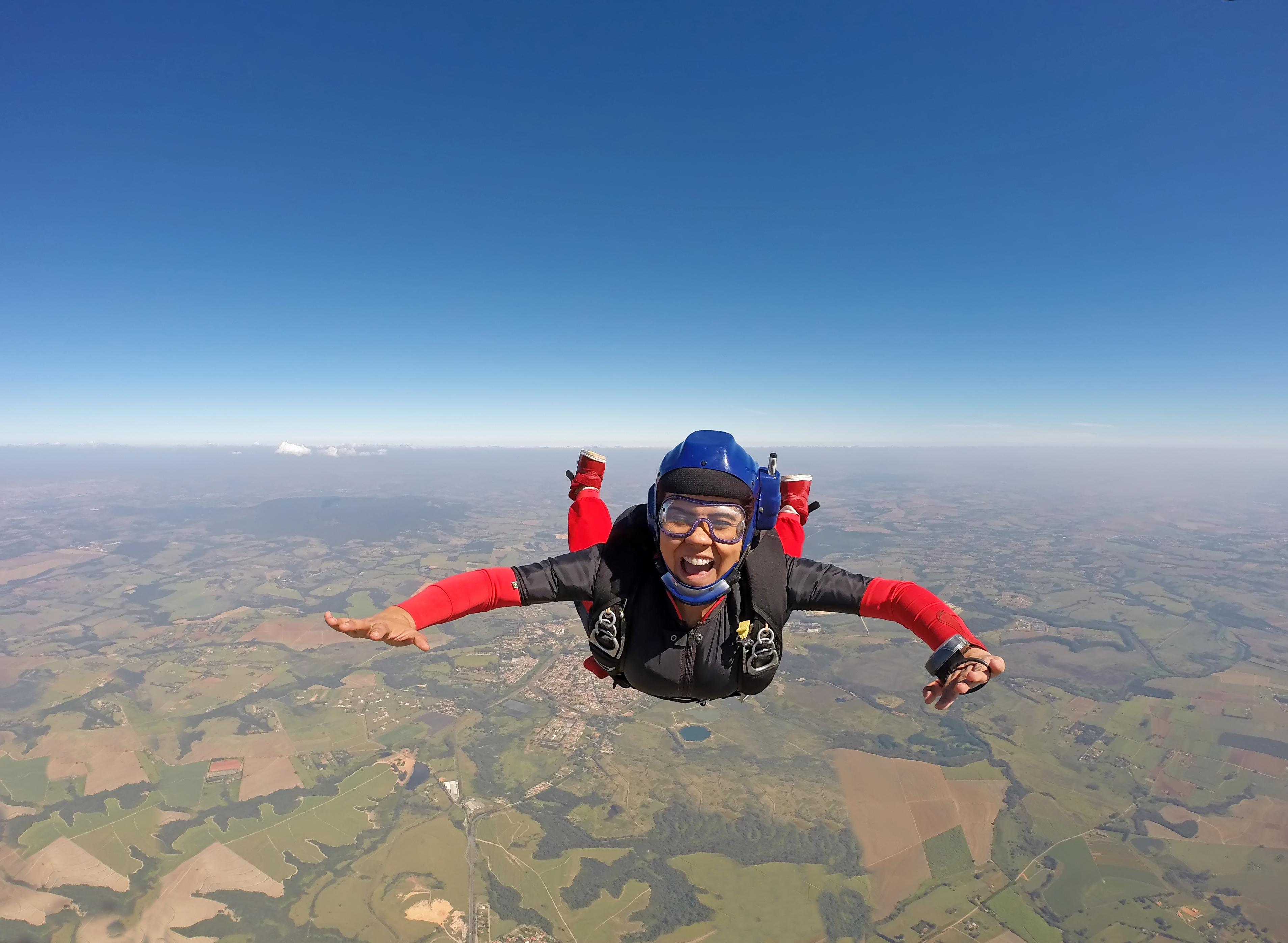smiling woman skydiving