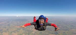 smiling woman skydiving
