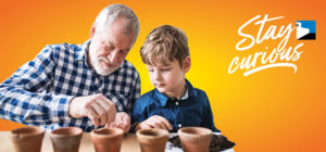 grandad & grandson planing seeds