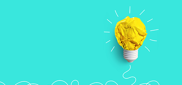 Creativity inspiration, ideas concepts with lightbulb from paper crumpled ball on pastel color background.