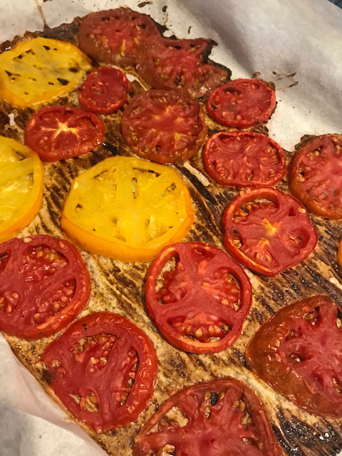 tomatoes on a baking sheet