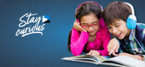 girl and boy reading and wearing headphones