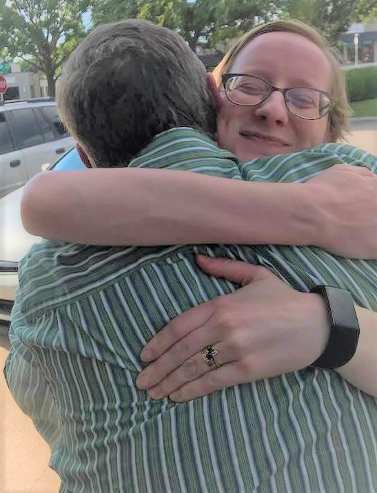 Debbie hugging her brother Mark