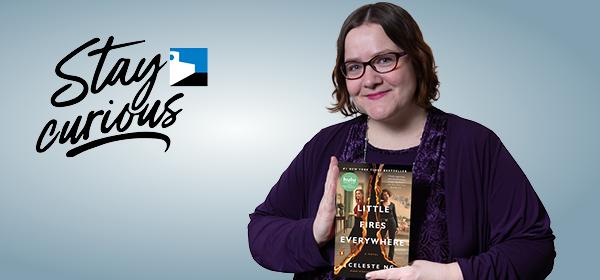 Miranda holding the book Little Fires Everywhere