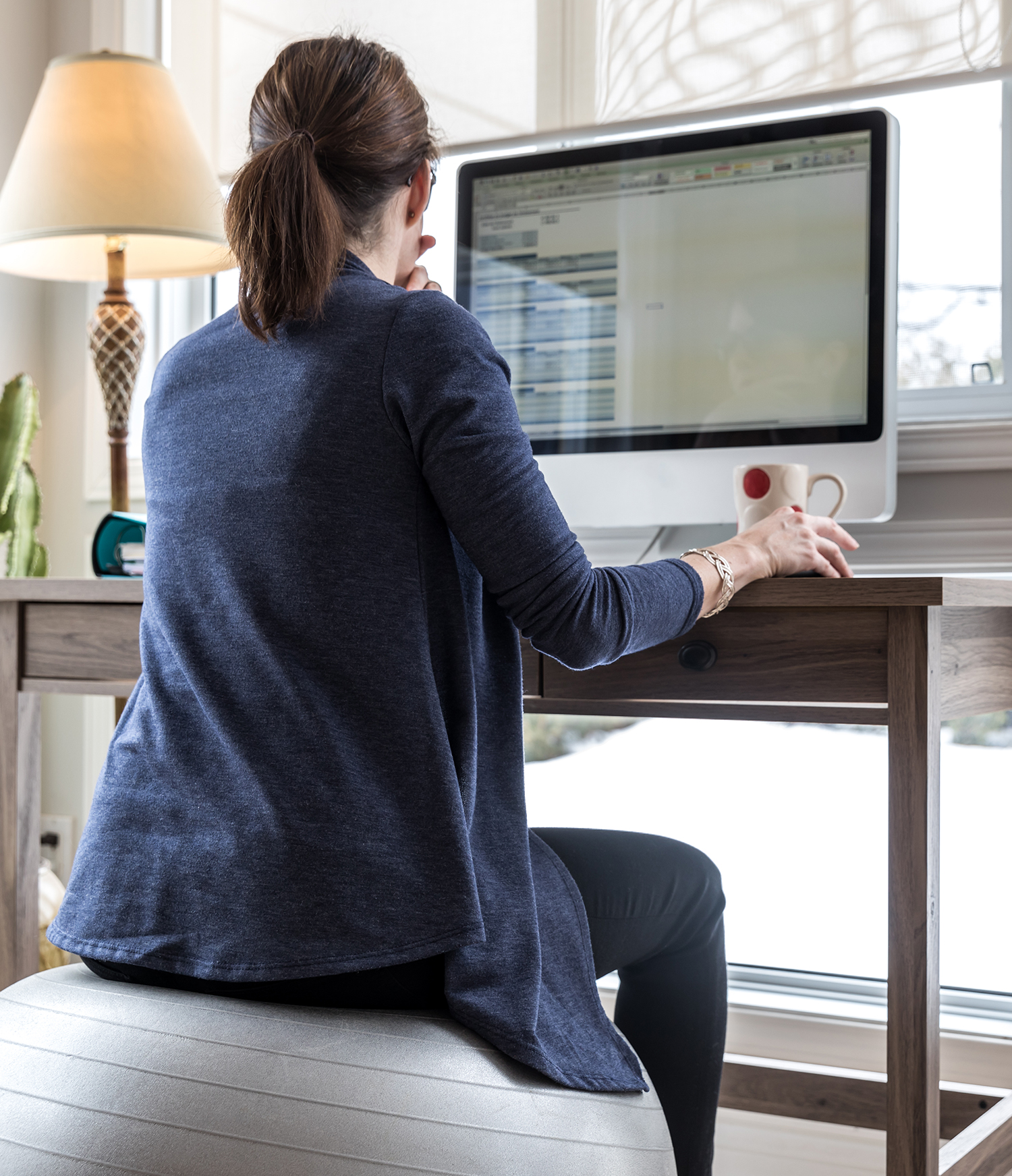 Woman Working From Home facing window