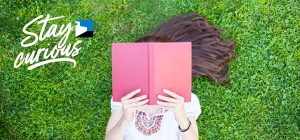 Teen reading in the grass
