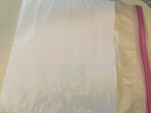 gallon-size zip bag with white paper inside