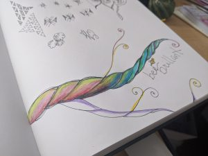 "Julie's art journal page updated with rainbow colors on the branch and the words ""Bee Brilliant"" written underneath"