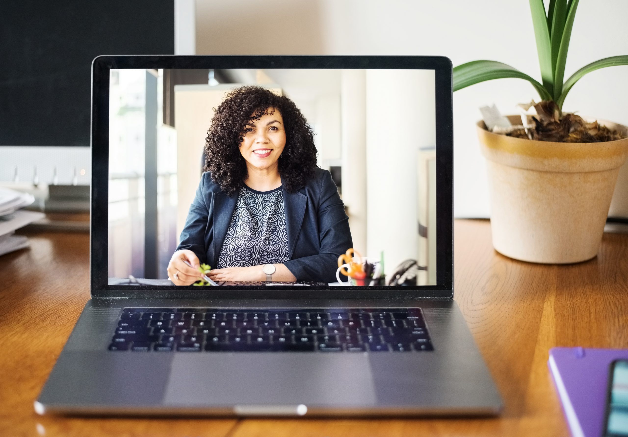 businesswoman having a video call on a laptop