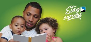 dad reading to toddlers