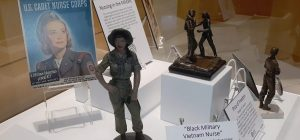 Display of nurse figurines and recruitment posters