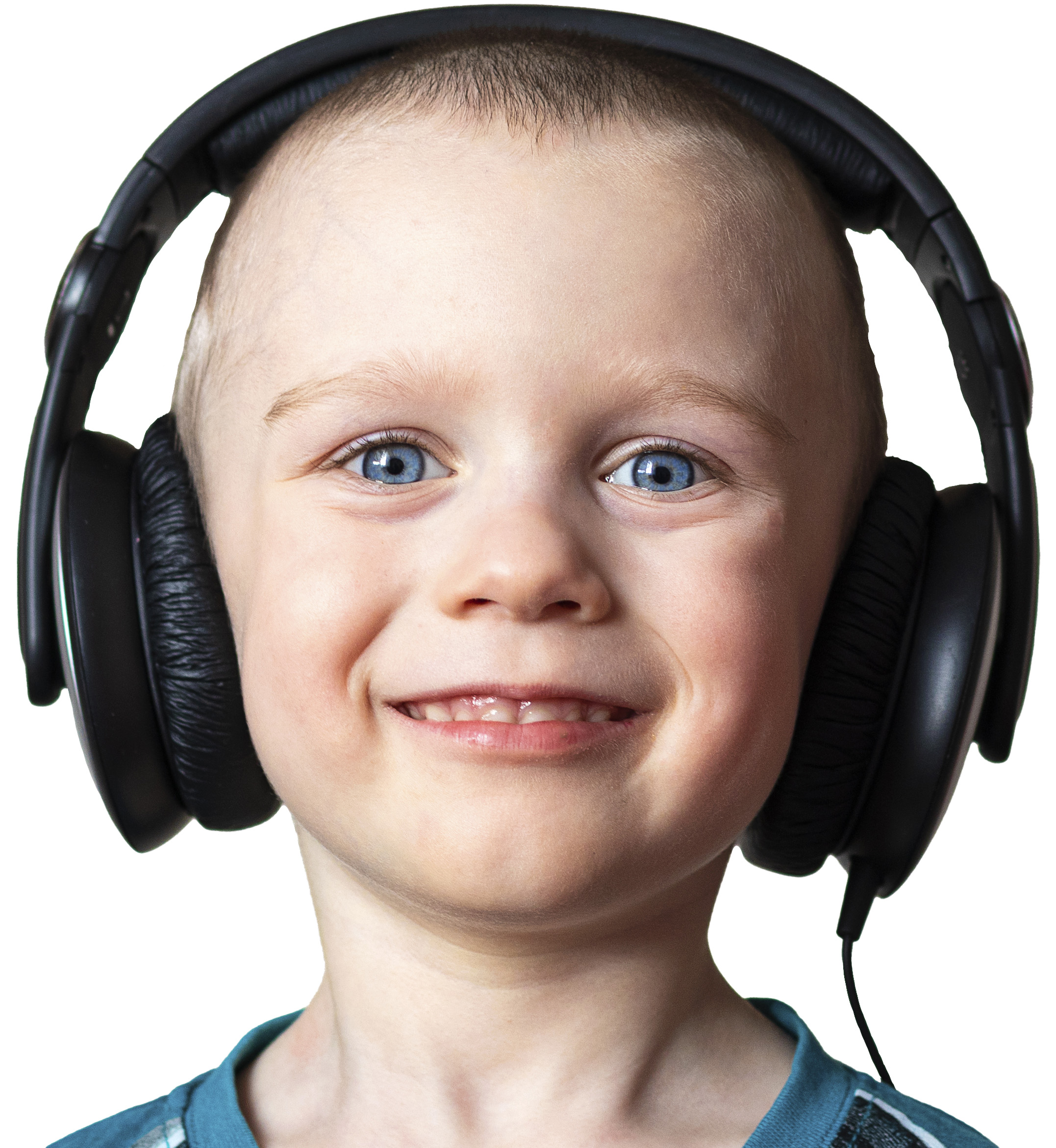 Happy child with headphones listening to music.