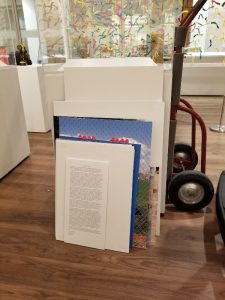 text panels and display case with dolly