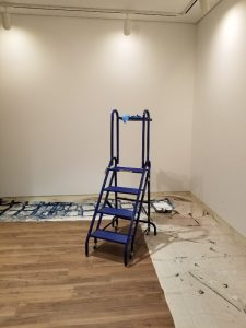 ladder and drop cloths for painting
