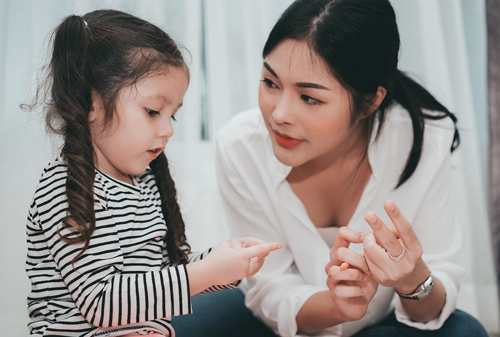 Mother teach daughter counting numbers finger, Parent and kid education preschool or kindergarten tutor at home family lifestyle.