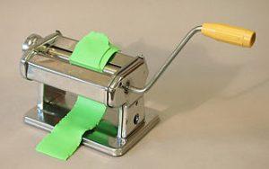 polymer clay being run through pasta machine
