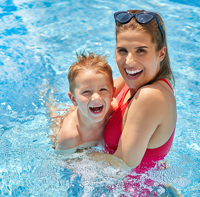 boy and mom swimming