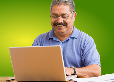 man happily working at computer