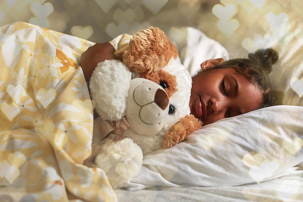 little girl sleeping with stuffed animal